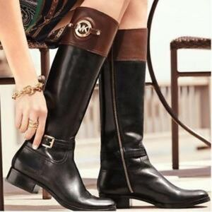 Black and Brown riding boots with MK emblem
